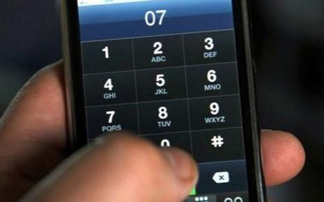 Usager du téléphone portable / AFP